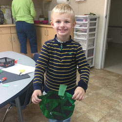 A child holding a craft project