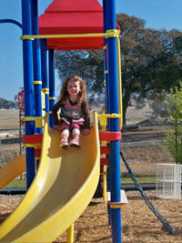 A child on a slide at a playground